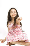 Cute young girl pointing Stock Photography