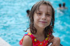 Cute young girl by pool Royalty Free Stock Image