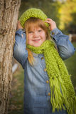 Cute Young Girl Poses Wearing Green Scarf and Hat Royalty Free Stock Photo