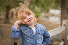 Cute Young Girl Posing for a Portrait Outside Stock Photo