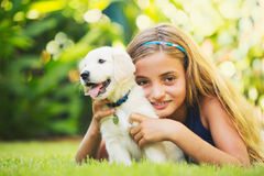 Cute Young Girl with Puppies Royalty Free Stock Photo