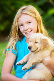 Cute Young Girl with Puppies Stock Photography
