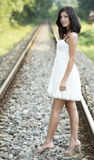Cute young girl on a railroad Stock Images