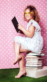 Cute young girl reading. Royalty Free Stock Photography