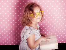 Cute young girl reading. Royalty Free Stock Photo