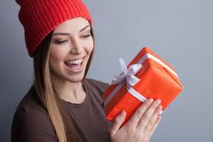 Cute young girl is receiving a present Royalty Free Stock Photography