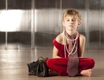 Cute young girl in red stock photos