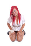 Cute young girl with red hair kneeling isolated Stock Photos