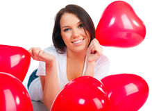 Cute young girl with a red hearts Stock Photos