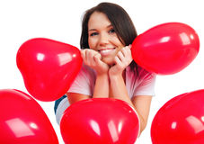 Cute young girl with a red hearts Stock Image