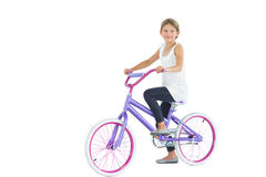 Cute young girl riding bike Stock Images