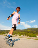 Cute young girl rollerskates Royalty Free Stock Images