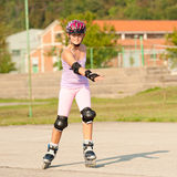 Cute young girl rollerskates Royalty Free Stock Photos