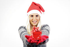 Cute young girl with Santa Claus hat, holding a present. Young girl with Santa Claus hat, holding a present Stock Image