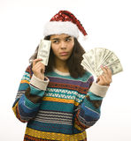 Cute young girl in santas red hat with money isolated Royalty Free Stock Photos