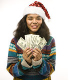 Cute young girl in santas red hat with money isolated Stock Photography