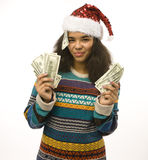Cute young girl in santas red hat with money isolated Stock Image