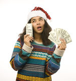 Cute young girl in santas red hat with money isolated Stock Images