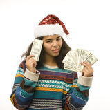 Cute young girl in santas red hat with money isolated Royalty Free Stock Images