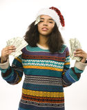 Cute young girl in santas red hat with money isolated Stock Photo