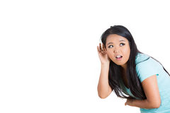 A cute young girl secretly listening to a private conversation Stock Images