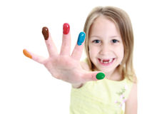 Cute young girl showing finger paints on her hand Royalty Free Stock Photo