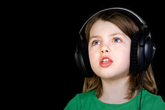 Cute Young Girl Singing with Headphones Royalty Free Stock Photos