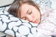 Cute young girl sleeping hugging pillow Royalty Free Stock Photos