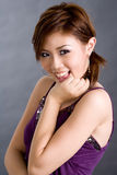 Cute young girl smile. Cute looking young girl smiling at the camera Royalty Free Stock Image