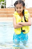Cute young girl standing in a pool Royalty Free Stock Photo