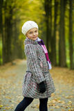 Cute young girl standing turned backwards Stock Photos