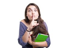 Cute young girl student making silence gesture Stock Photography