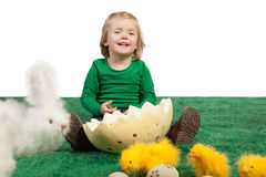 Cute young girl with toy bunny and chicks Royalty Free Stock Photography