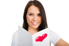 Cute young girl with a Valentine's card Royalty Free Stock Images