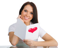 Cute young girl with a Valentine's card Stock Photo