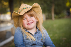 Cute Young Girl Wearing Cowboy Hat Posing for Portrait Outside Stock Photos