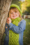 Cute Young Girl Wearing Green Scarf and Hat Royalty Free Stock Image