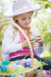 Cute Young Girl Wearing Hat Enjoys Her Easter Eggs Stock Images