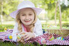 Cute Young Girl Wearing Hat Enjoys Her Easter Eggs Stock Photography