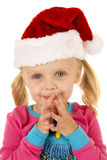 Cute young girl wearing a santa hat with her hands together Royalty Free Stock Photo