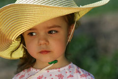 Cute young girl with yellow straw hat. Adorable child girl with yellow straw hat and  looking away Stock Images