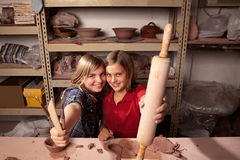 Cute young girls in clay studio Stock Image