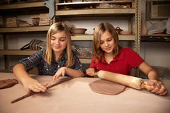 Cute young girls in a clay studio Royalty Free Stock Photos