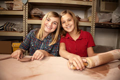 Cute young girls in a clay studio Stock Photography