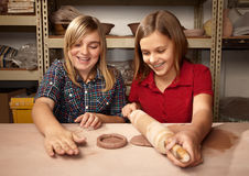 Cute young girls in a clay studio Stock Photo