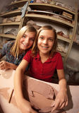 Cute young girls in a clay studio Stock Photos