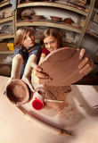 Cute young girls in a clay studio Royalty Free Stock Images
