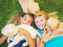 Cute Young Girls with Puppies Royalty Free Stock Image