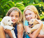 Cute Young Girls with Puppies Royalty Free Stock Photography