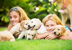 Cute Young Girls with Puppies Stock Photography